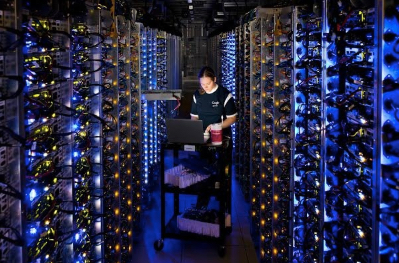 Image of Denise, a Google employee, diagnosing and overheated CPU data center in The Dalles, Oregon.