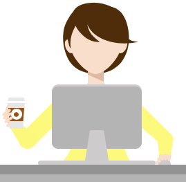 Image of a light skinned person with short hair sitting at a computer and holding a coffee cup