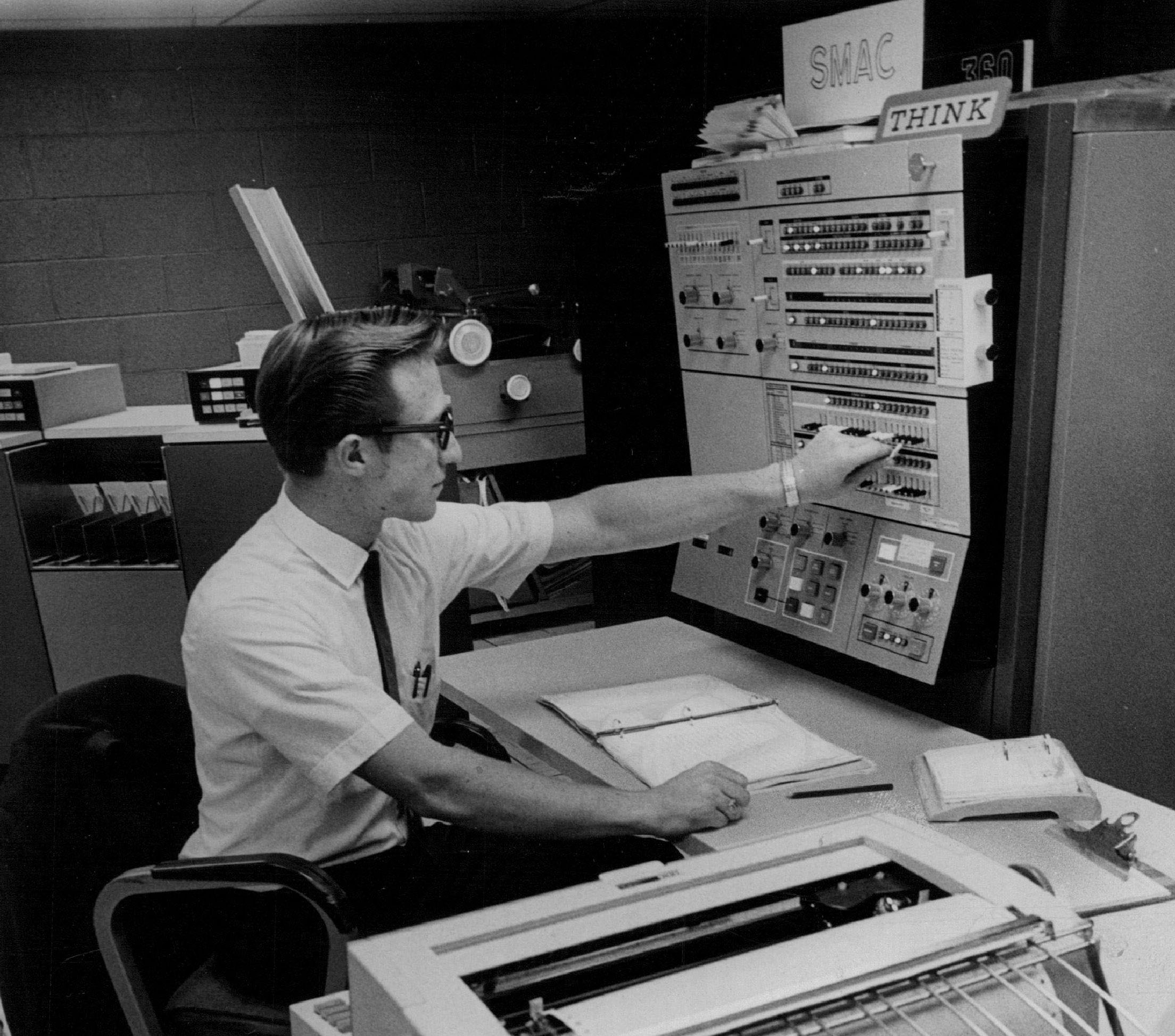 1970: St. Joseph Hospital; The computer has been put to work in the hospital. Man operates a large early computer console.