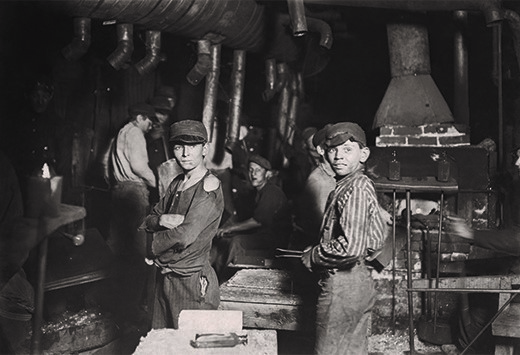 Lewis Hine took this photograph of children working in a New York glass factory at midnight. There, as in many other factories, children worked around the clock in difficult and dangerous conditions.