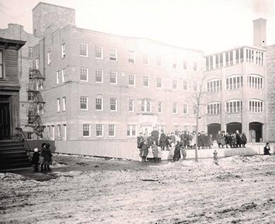 Children standing outside of Hull House, ca. 1907