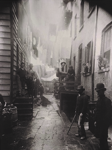 """59 1/2 Mulberry Street, otherwise known as """"Bandit's Roost"""" in the infamous Five Points neighborhood of Manhattan's Lower East Side. Riis took this photograph in 1888."""