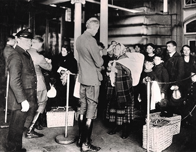 In the photo above, a public health official inspects a recently-arrived immigrant for signs of contagious illness at Ellis Island in New York. Most immigrants were admitted to the United States with only a cursory glance at their paperwork, but those who had infections, disabilities, or a criminal history were often turned back.