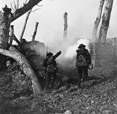 U.S. soldiers run past fallen Germans on their way to a bunker.