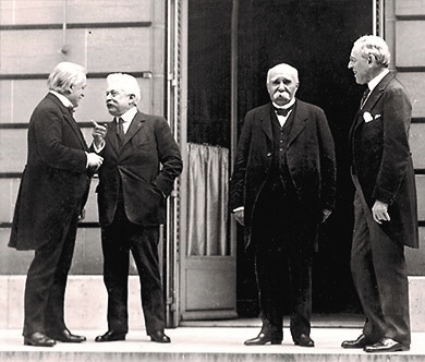 This photograph shows a meeting of the leaders of the Allied Powers: (from left to right) Prime Minister David Lloyd George of Great Britain; Vittorio Emanuele Orlando, Prime Minister of Italy; Georges Clemenceau, Prime Minister of France; and President Woodrow Wilson.
