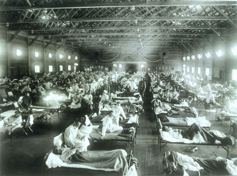 The flu pandemic that came home with the returning troops swept through the U.S., as evidenced by this overcrowded flu ward at Camp Funston, Kansas.