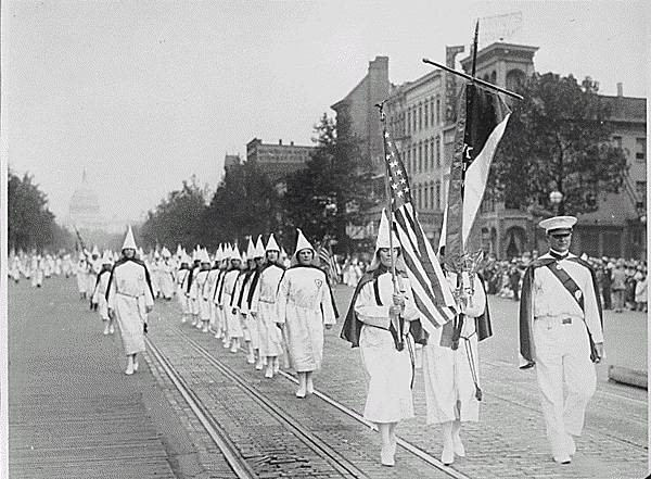 Female members of the Ku Klux Klan march down Pennsylvania Avenue in Washington, D.C. in 1928. Note the dome of the U.S. Capitol in the background.