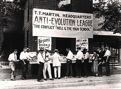 During the Scopes Monkey Trial, supporters of the Butler Act read literature at the headquarters of the Anti-Evolution League in Dayton, Tennessee.