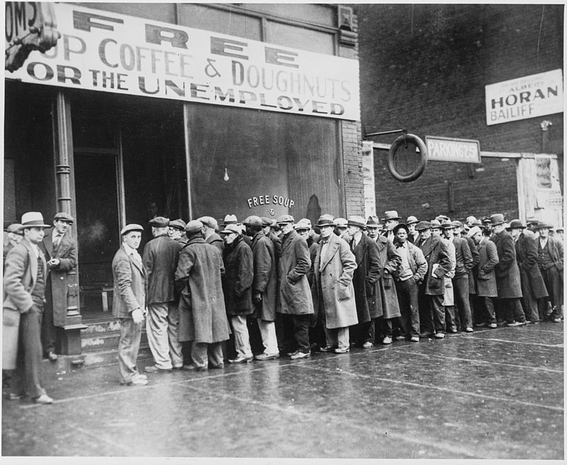 Men stand outside a soup kitchen in Chicago opened by Al Capone in February of 1931.