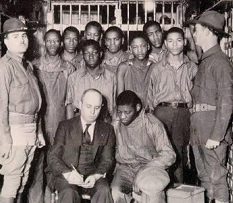 The Scottsboro Boys with their lawyer, Samuel Liebowitz.