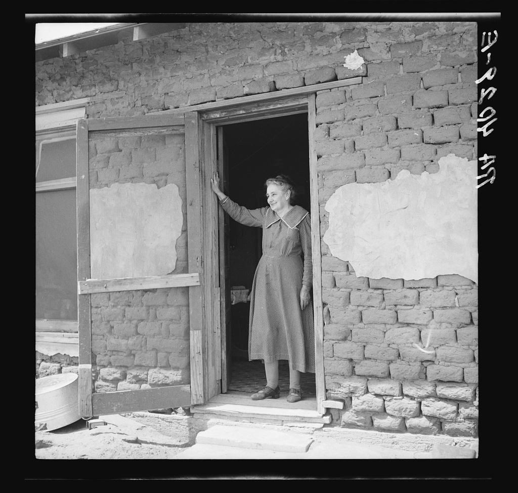 """Photograph titled, """"One of the pioneer women of the Oklahoma Panhandle dust bowl"""", taken by Arthur Rothstein in April 1936."""