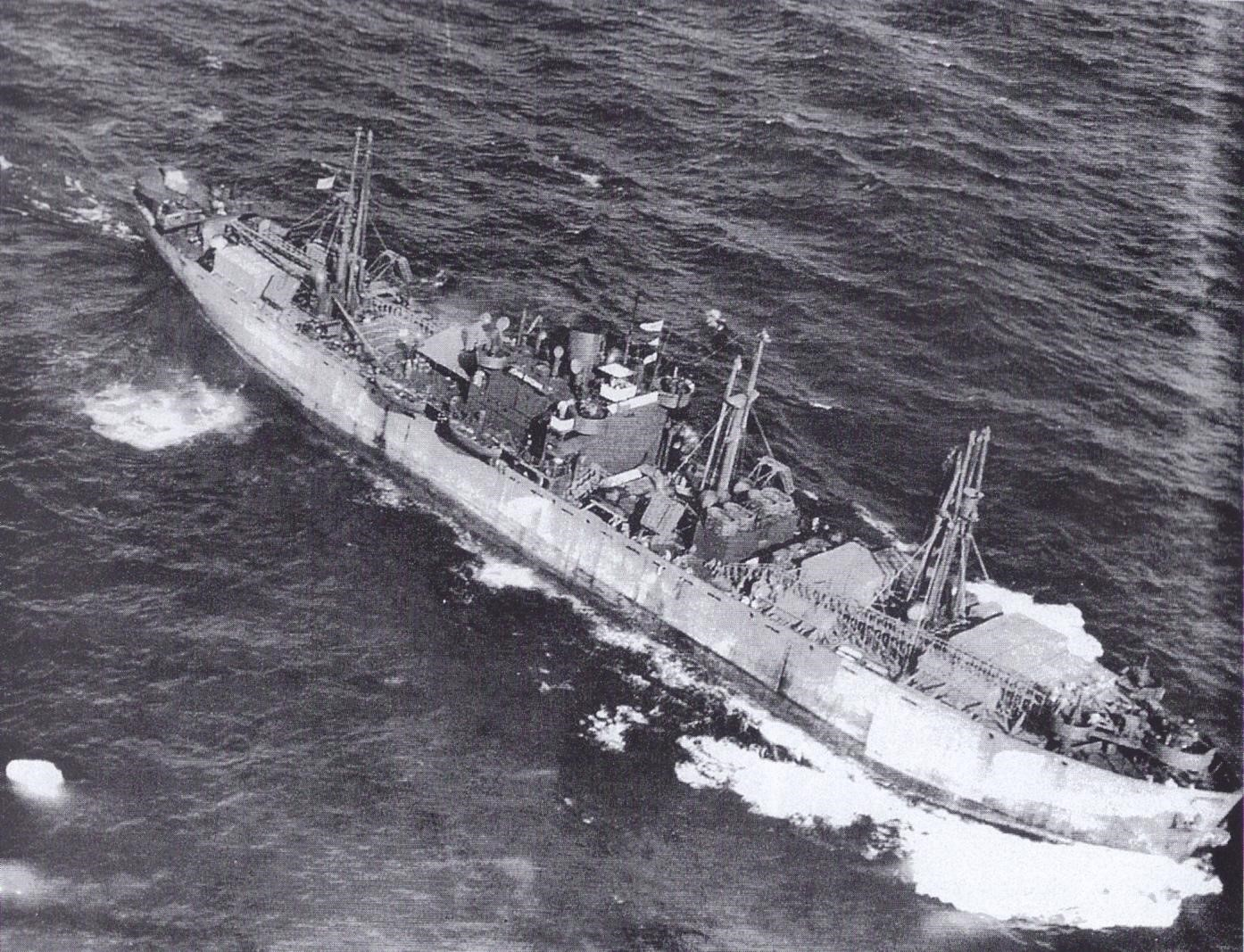 A 1943 photograph of the SS John W. Brown, a Liberty Ship departing from the United States with a deck full of cargo.
