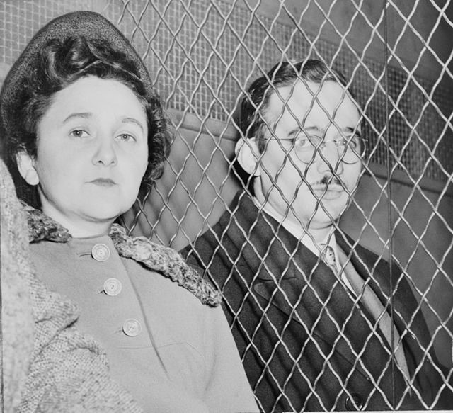 Julius and Ethel Rosenberg, separated by a heavy wire screen, shortly after being convicted of conspiracy in 1951. Historians have determined that Julius Rosenberg was likely guilty of giving atomic secrets to Soviet agents, but that the government had little evidence against his wife. Ethel Rosenberg may have been indicted to pressure her husband into providing the names of other spies.