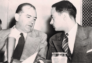 Senator Joseph McCarthy (left) consults with Roy Cohn (right) during the Army-McCarthy hearings.