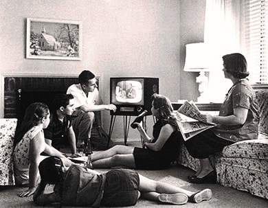 An American family relaxes in front of their television set in 1958.