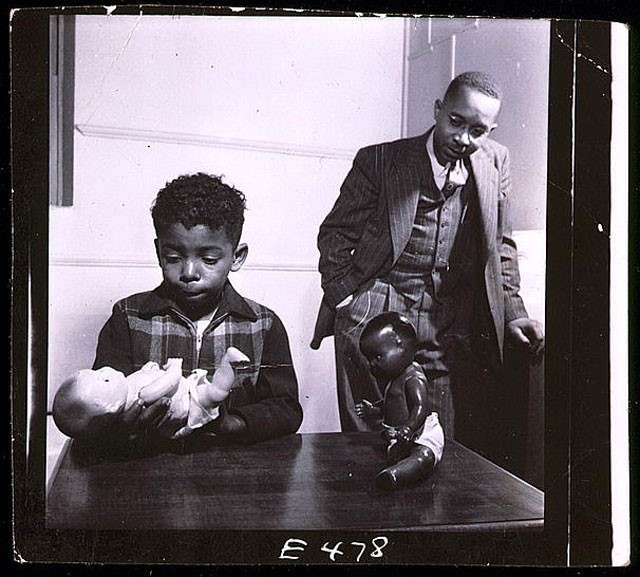 "Photograph of Kenneth Clark conducting the ""doll test"". It appeared in Ebony magazine in 1947."