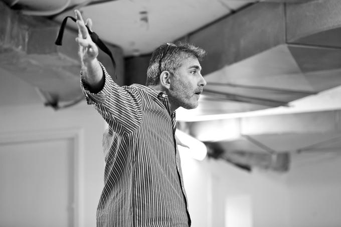 Rafi Niv, a performer and director, rehearses before going on stage.