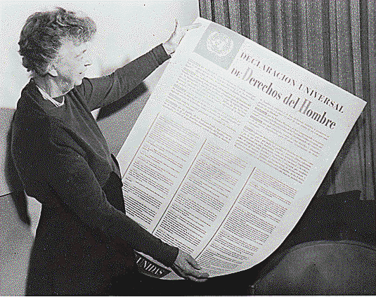 Eleanor Roosevelt examines a draft of the Universal Declaration of Human Rights written in Spanish.