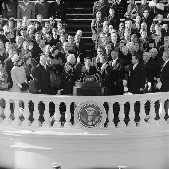 John F. Kennedy takes the oath of office on January 20, 1961.