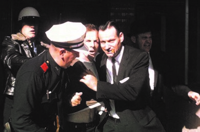 Lee Harvey Oswald (center) was arrested at the Texas Theatre in Dallas a few hours after shooting President Kennedy. No credible evidence has proven that someone other than Oswald murdered Kennedy, or that Oswald acted with co-conspirators.