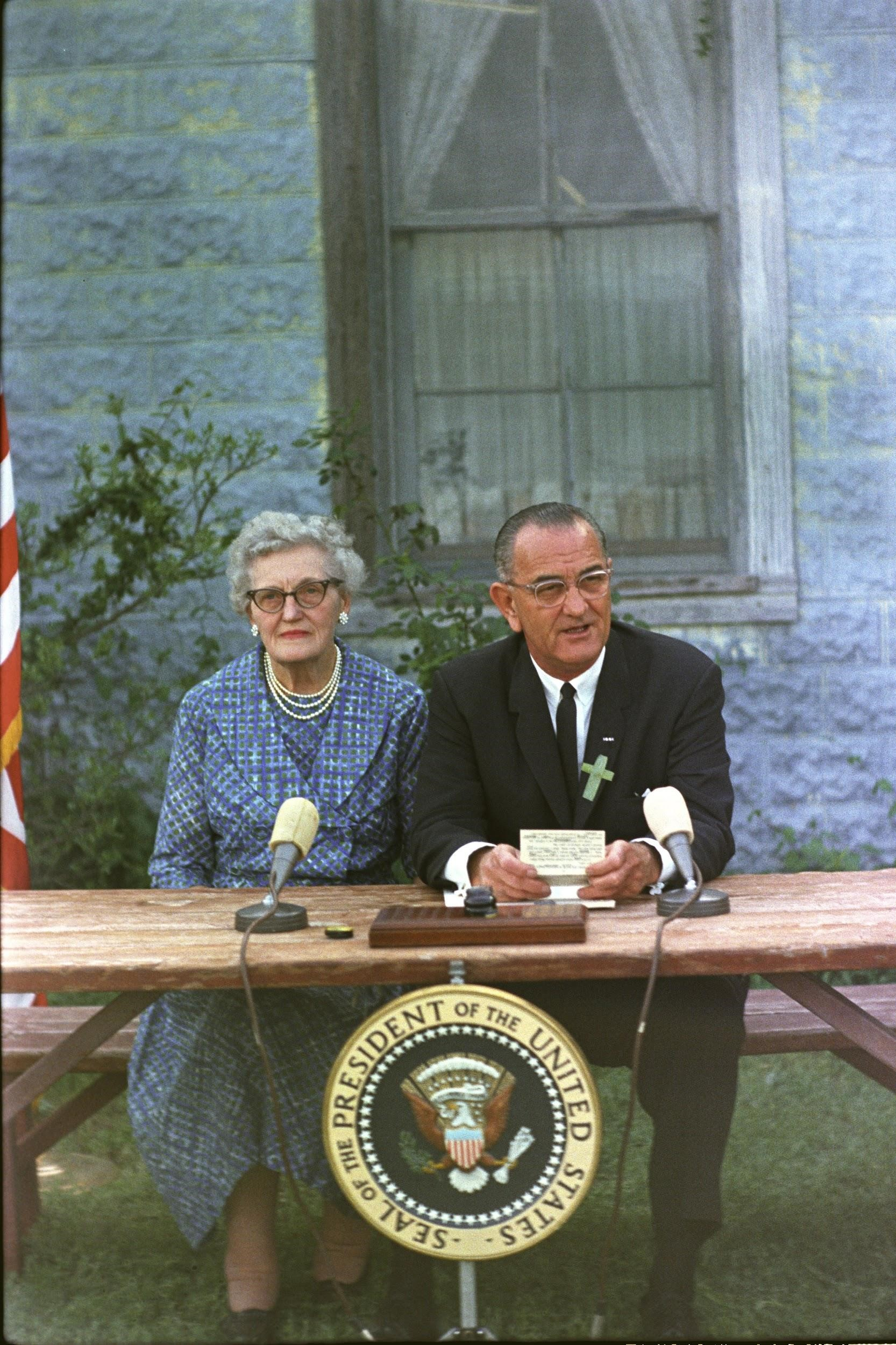 Johnson signed the Elementary and Secondary Education Act in his hometown of Johnson City, Texas, alongside his childhood schoolteacher, Kate Deadrich Loney. The Act ultimately allocated more than $1 billion for the purchase of books and library materials, the creation of educational programs for disadvantaged children, and other initiatives to promote quality education in public schools.