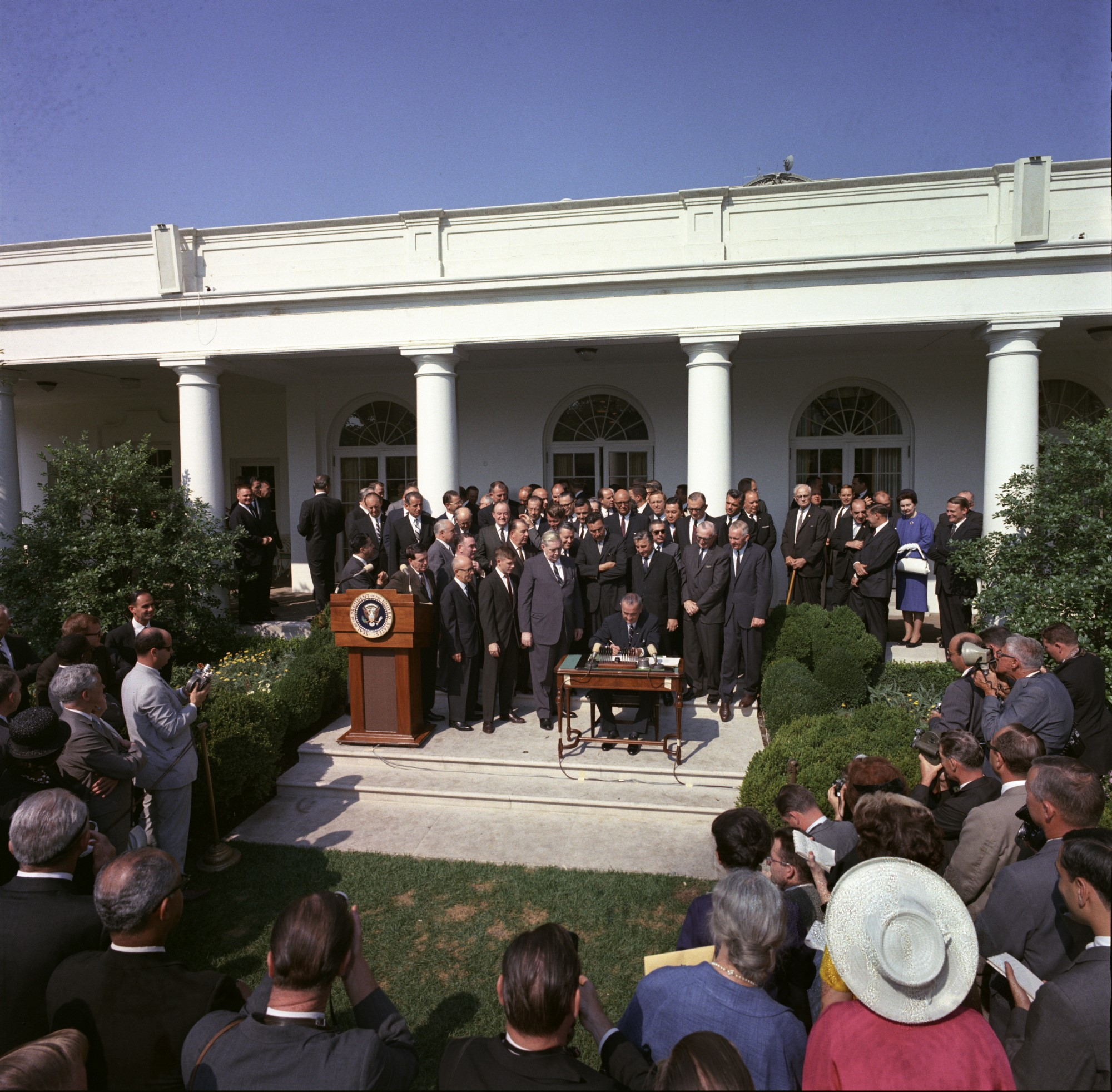 President Johnson signs the Economic Opportunity Act on August 20, 1964. The Act created the Office of Economic Opportunity (OEO), which oversaw many of the War on Poverty programs.