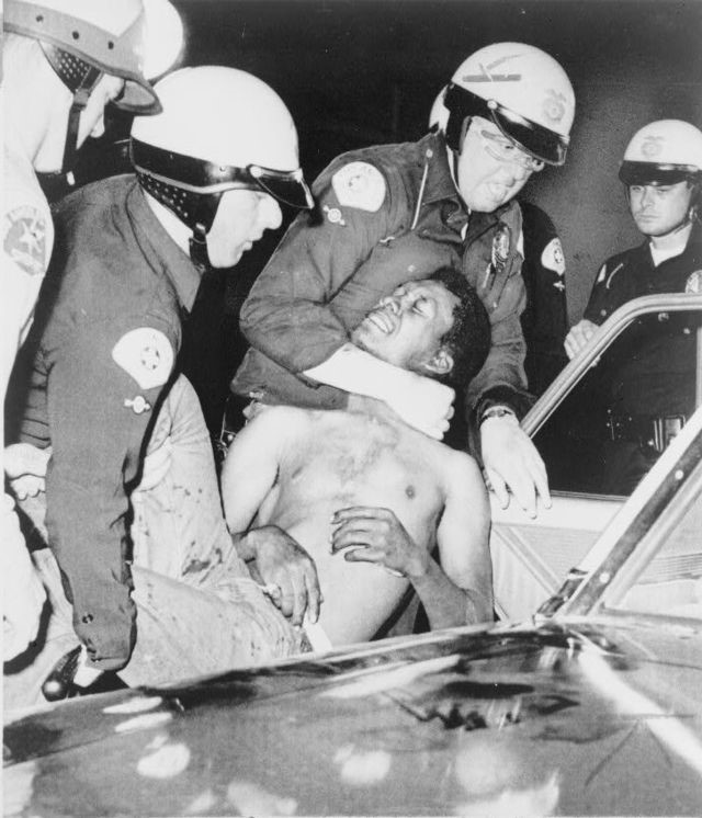 L.A. police arrest a black man during the Watts riots, August 12, 1965.