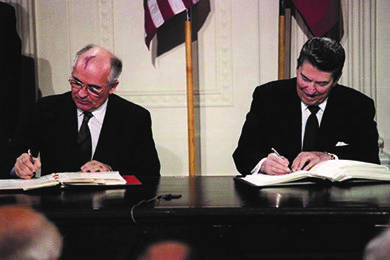 President Ronald Reagan (right) and Soviet Premier Mikhail Gorbachev (left) sign the 1987 INF Treaty in the East Room of the White House. The treaty marked the first time that both superpowers agreed to do away with an entire category of nuclear weapons.