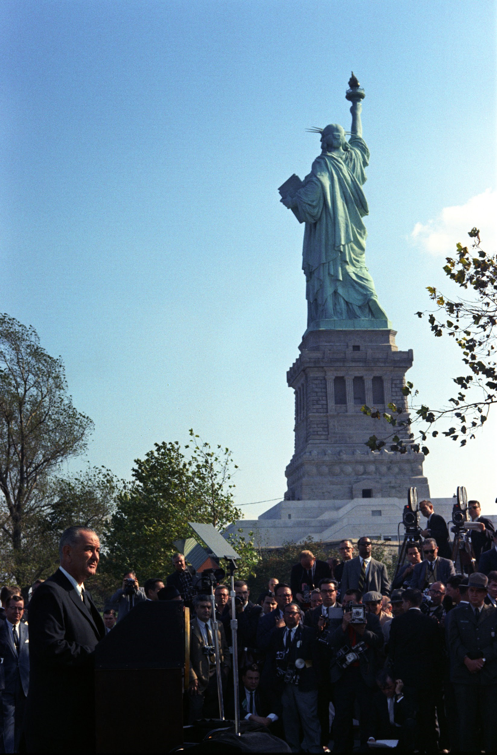 President Lyndon B. Johnson visits the Statue of Liberty to sign the Immigration and Nationality Act of 1965.
