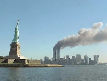The Statue of Liberty with the World Trade Center burning in the background on the morning of September 11, 2001.