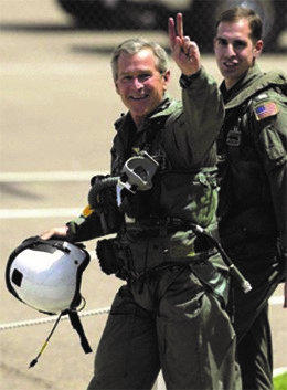 President Bush gives the victory symbol on the aircraft carrier USS Abraham Lincoln in May, 2003.