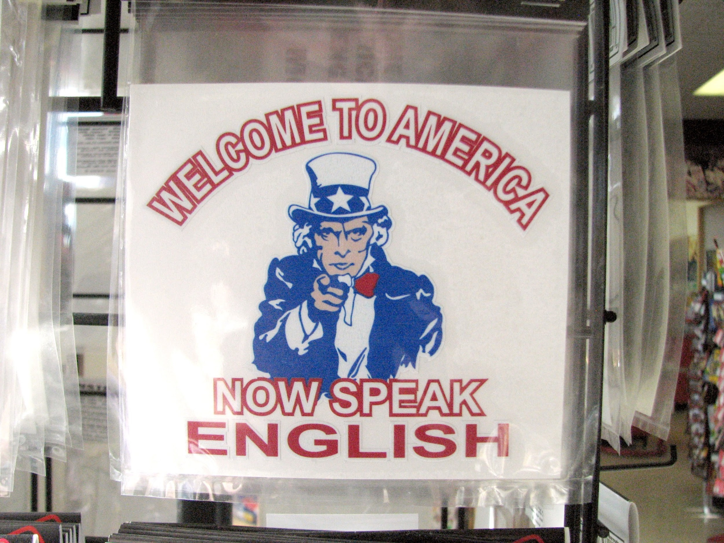 A bumper sticker demanding that immigrants speak English reflects a perception that recent immigrants have not assimilated into American culture
