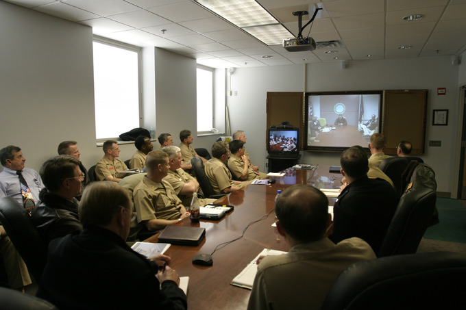 Remote Audience - Rear Adm. J. Kevin Moran, the commander at the Naval Personnel Development Command (NPDC) in Norfolk, Virginia, speaks by video conference to an audience at the Center for Aviation Technical Training (CNATT).