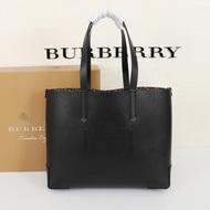 Burberry Embossed Monogram Motif Leather Tote In Black