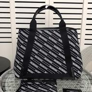 Balenciaga Allover Diagonal Logo Navy Meidium Cabas In Black